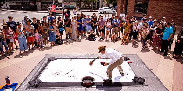 Street performer featured December LTSCene Newsletter