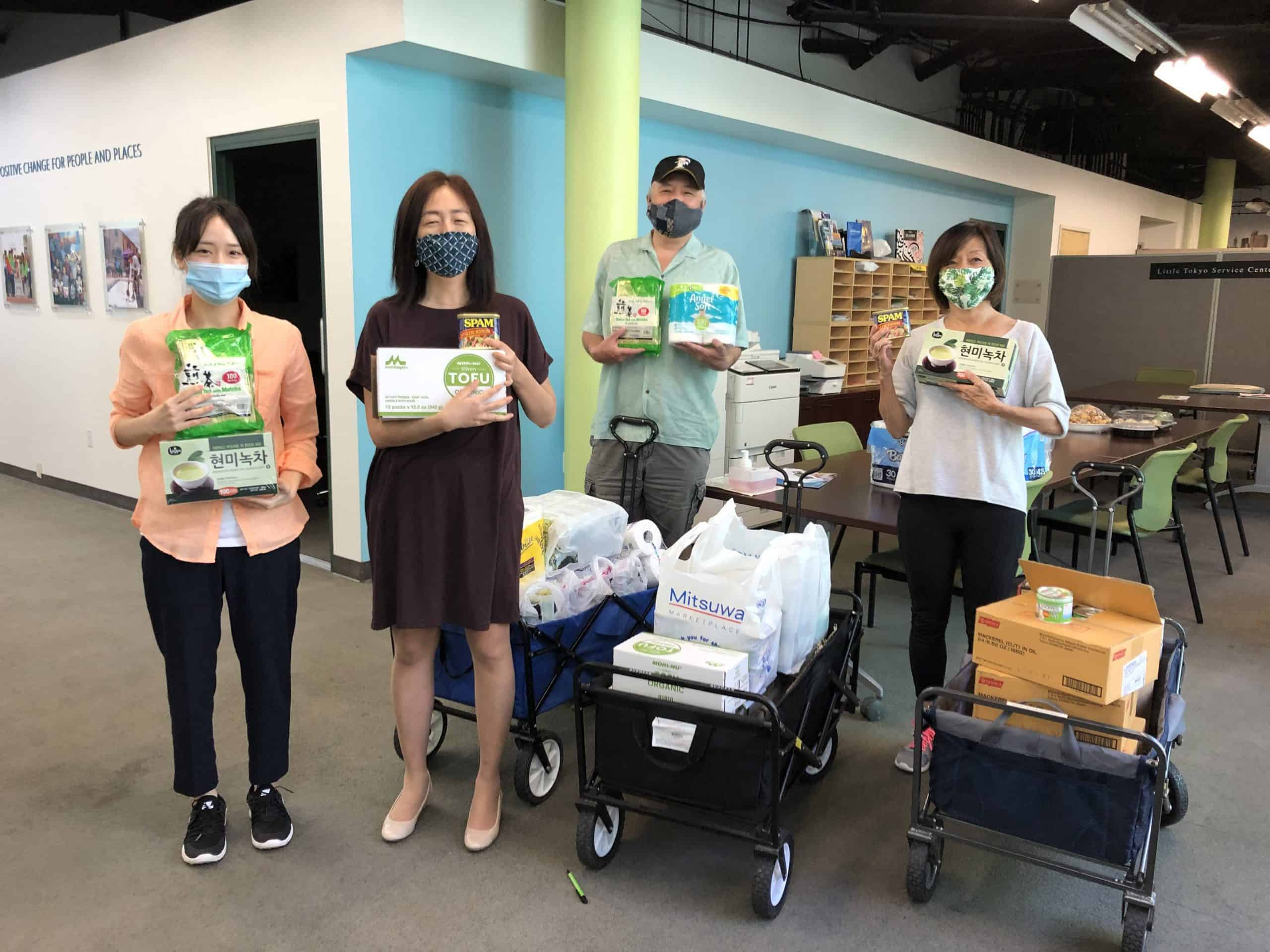 LTSC social service staff deliver food to seniors in Little Tokyo
