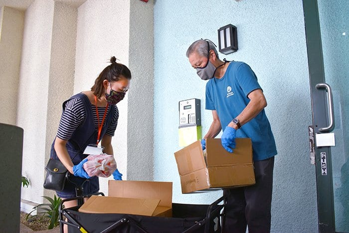 LTSC staff load boxes of food for delivery to residents
