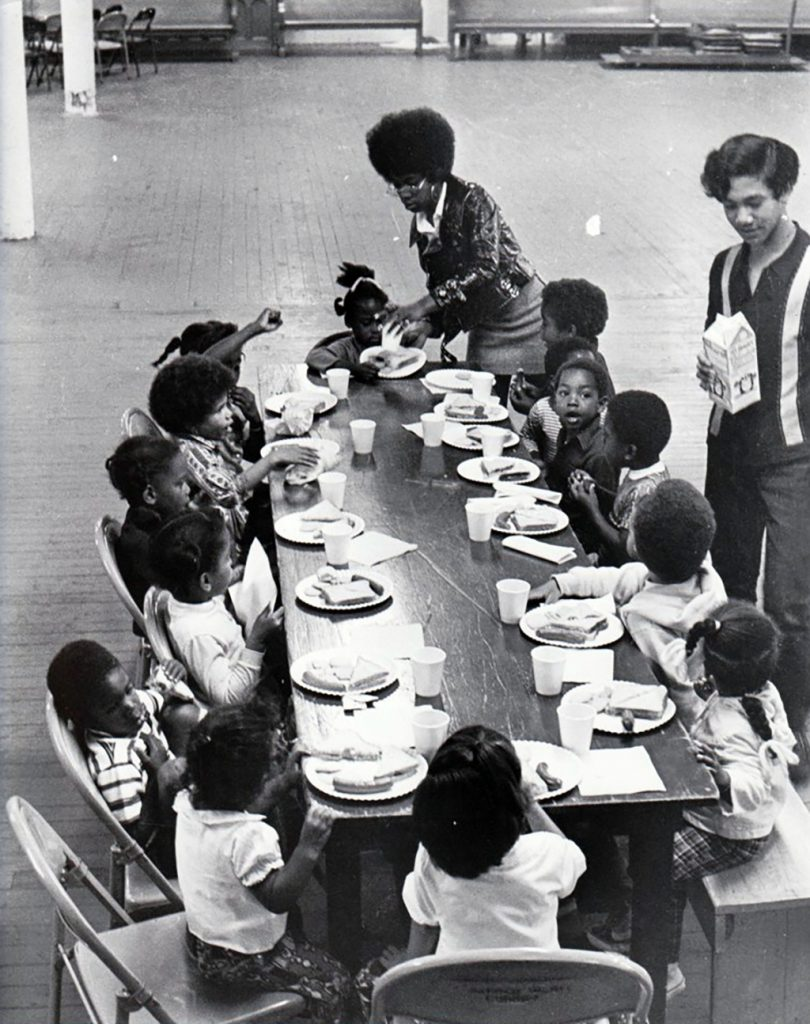 Image: Panthers serving children free breakfast, Sacred Heart Church, San Francisco. Photo by Ducho Dennis,It's About Time Archive.
