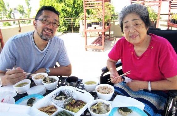 Kenji Suzuki eating with his mother Junko Suzuki, owners of the family business Suehiro