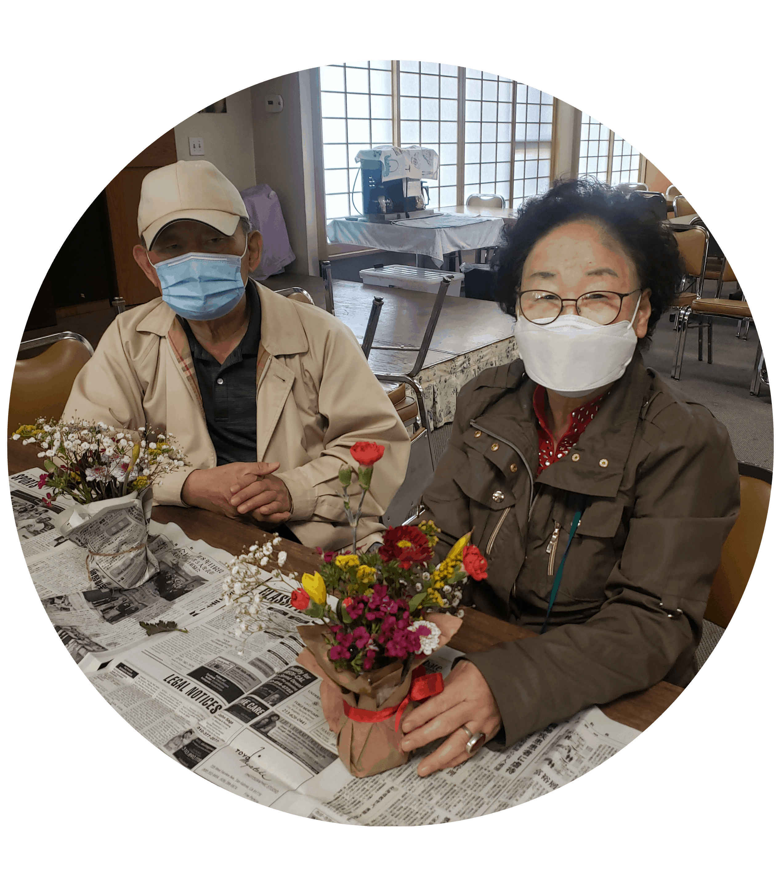 two seniors making ikebana flower arrangements