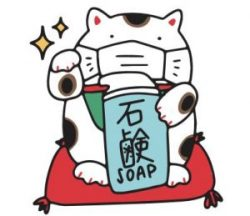 Maneki Neko holding a bar of soap
