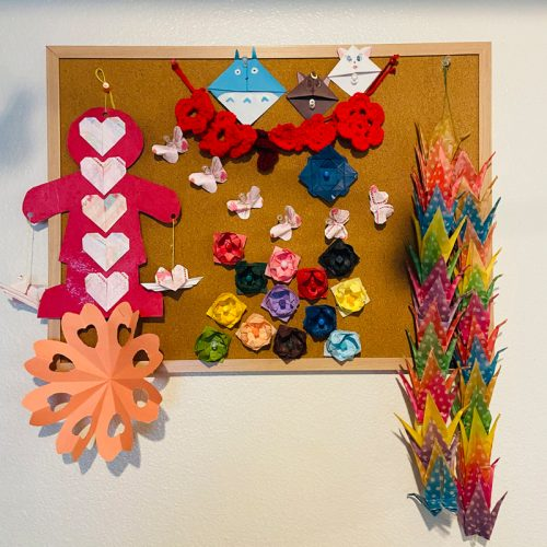 various origami cranes and flowers