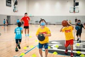 Camp attendees shooting basketballs
