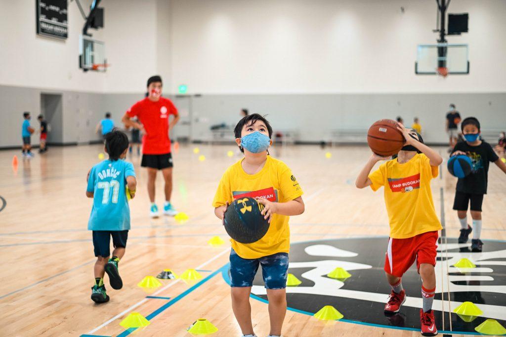 kids play basketball at Budokan